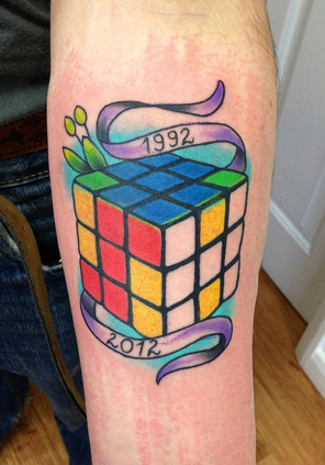 Arm Rubick Tattoo by Bananas Tattoo