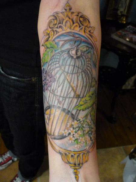 Arm Mirror Cage Tattoo by DC Tattoo Saloon
