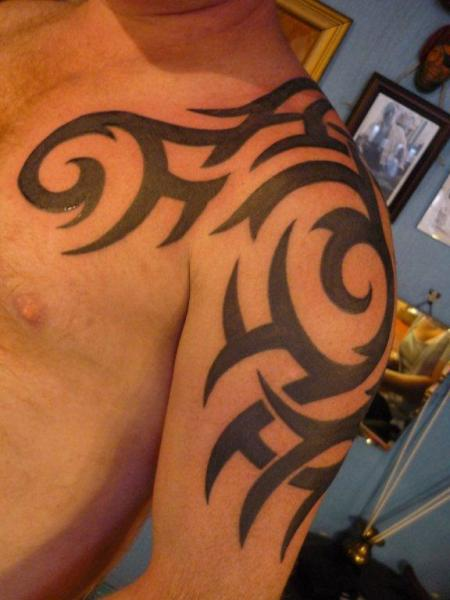 Shoulder Tribal Tattoo by DC Tattoo Saloon